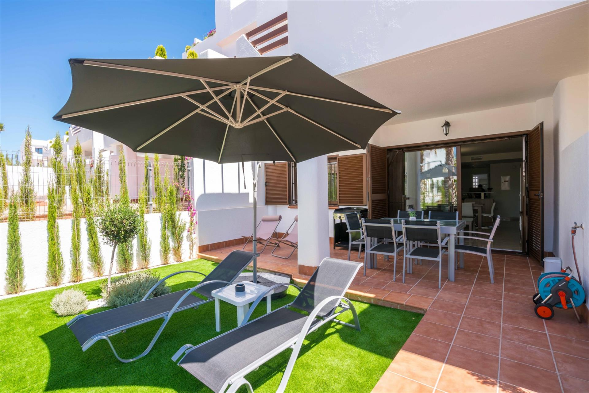 Kaki, Lovely and cheerful apartment in San Juan de los Terreros, Andalusia, Spain  with communal pool for 4 persons.....