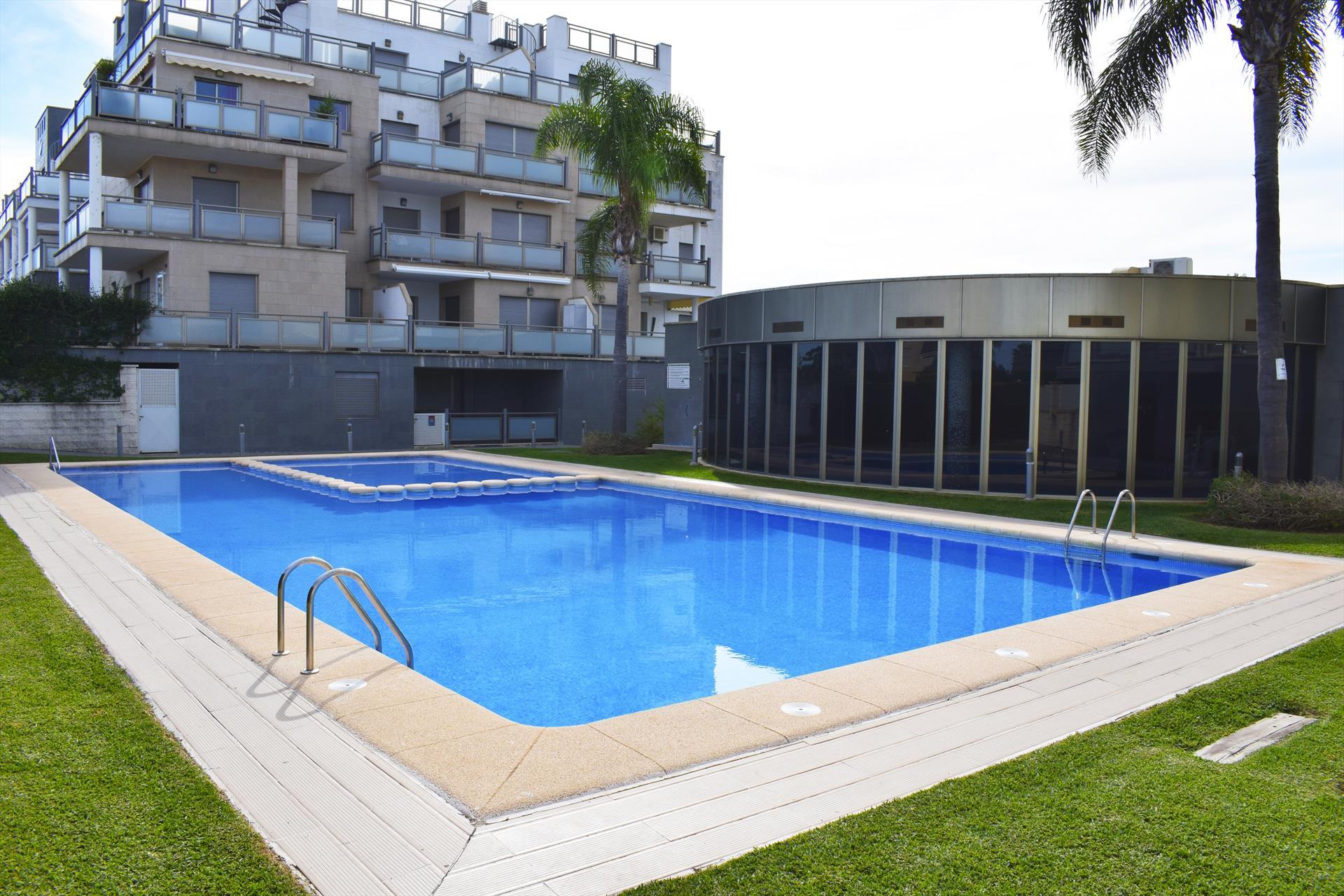 Cabagua Oliva Nova AP570,Apartamento maravilloso y gracioso  con piscina comunitaria en Oliva, en la Costa Blanca, España para 4 personas.....