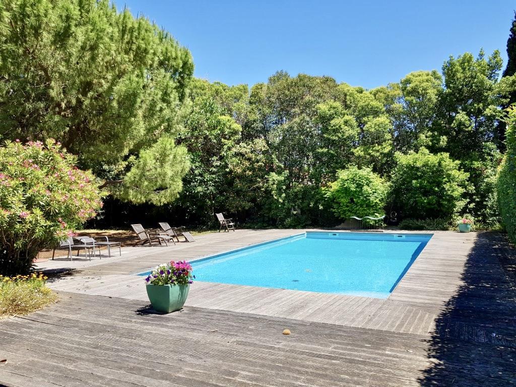 Le petit gite de simone,Mooi en comfortabel appartement  met gemeenschappelijk zwembad in Ginestas, Languedoc Roussillon, Frankrijk voor 3 personen...