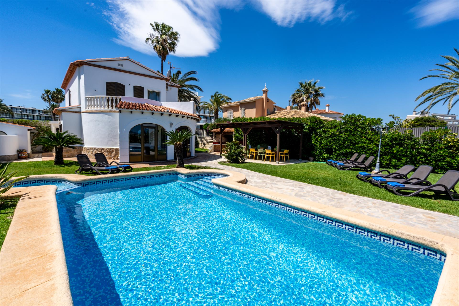 Villa Neptun, Villa in Denia, on the Costa Blanca, Spain with private pool for 12 persons. The villa is situated at 25 m from Almadrava.....