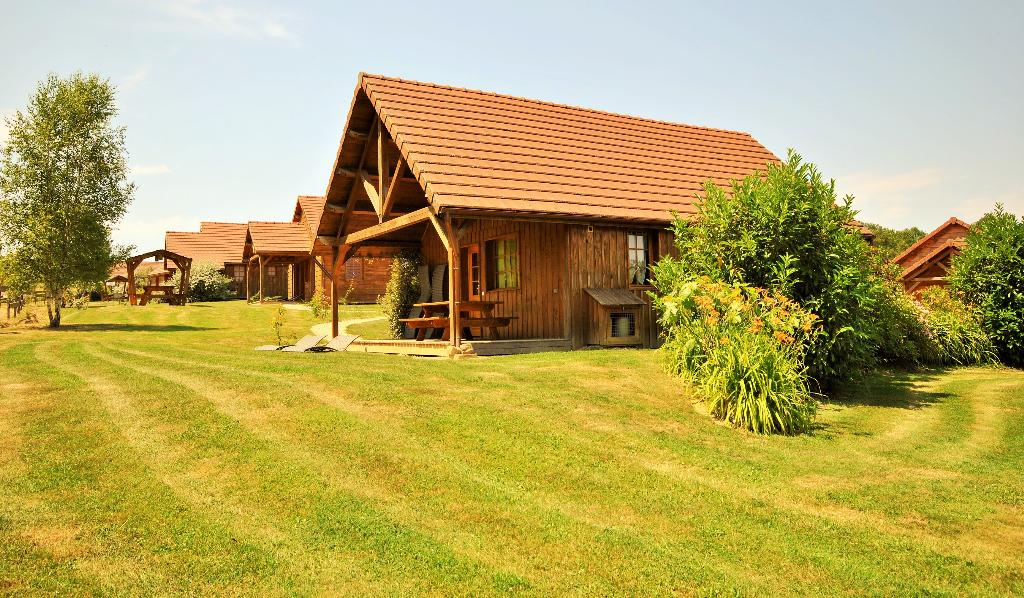 Chalet C2, Large and cheerful holiday house in Saint Fargeau en Puisaye, Burgundy, France with communal pool for 8 persons. This resort.....