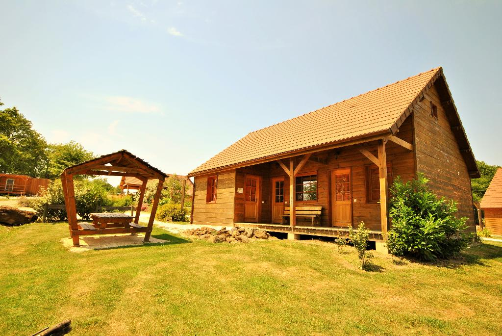 Chalet C1, Large and cheerful holiday house in Saint Fargeau en Puisaye, Burgundy, France with communal pool for 8 persons. This resort.....