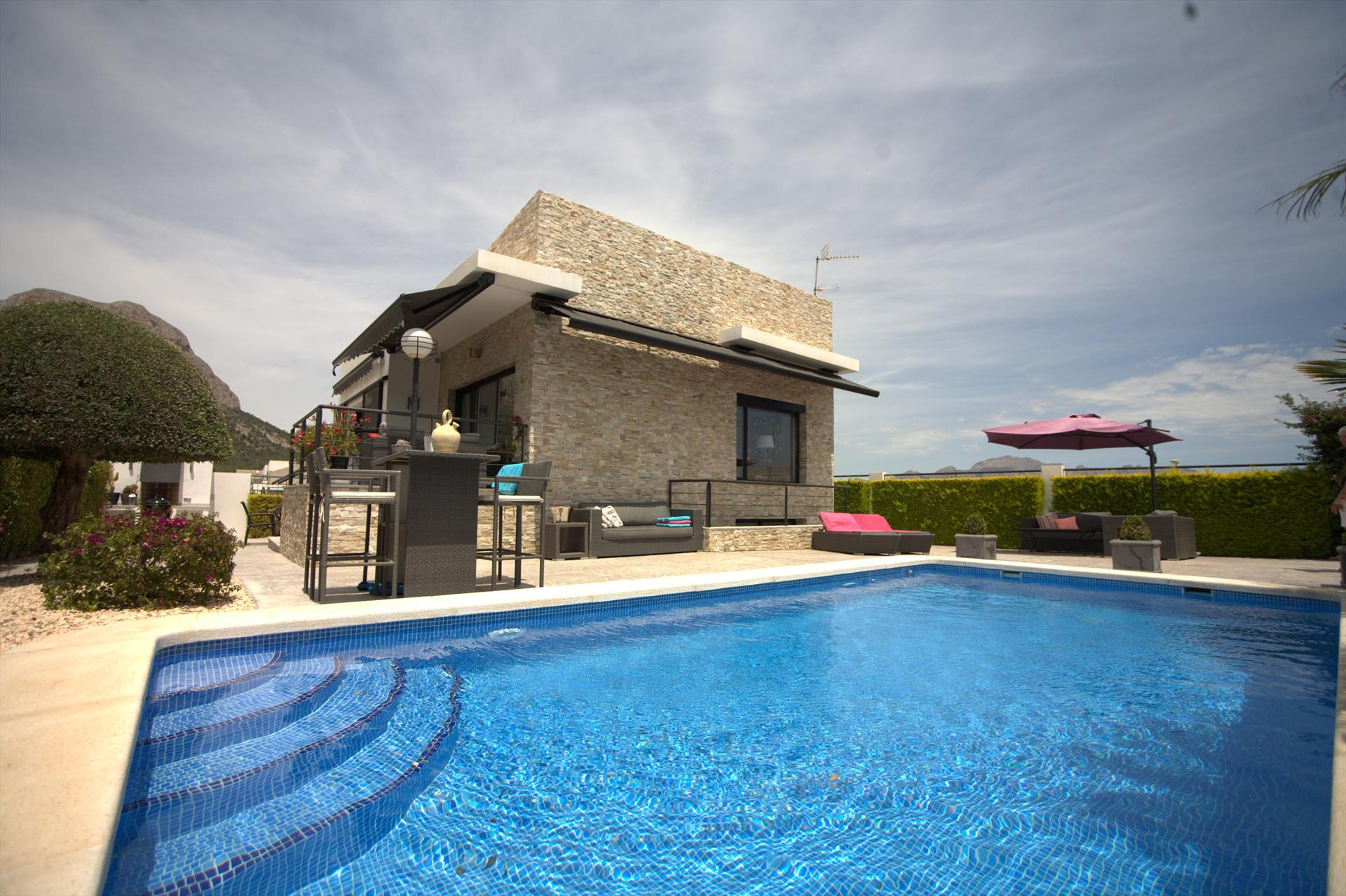 Casa Pimienta 8, RENT A HOLIDAYVILLA IN POLOP, COSTA BLANCA.Modern new house, 2 floors situated in a quiet modern urbanisation and very well.....